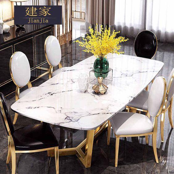 Elementos para decorar un comedor con mármol y color dorado